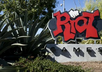 A logo sign outside of the headquarters of Riot Games, Inc., in Los Angeles, California on September 15, 2018. (Photo by Kristoffer Tripplaar/Sipa USA)