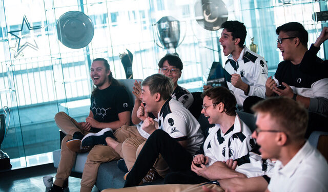 Team Liquid celebrates after group draw